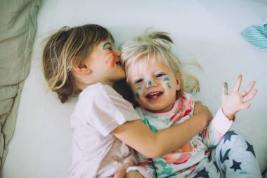 little sisters with painted faces