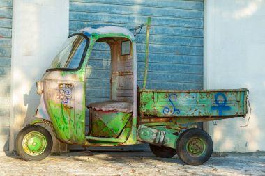 Old hippy apecar in Castelmola, Sicily. The Italian Piaggio Ape,