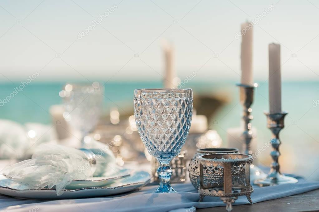 Beautiful Decorated Romantic Wedding Table on Sandy Beach