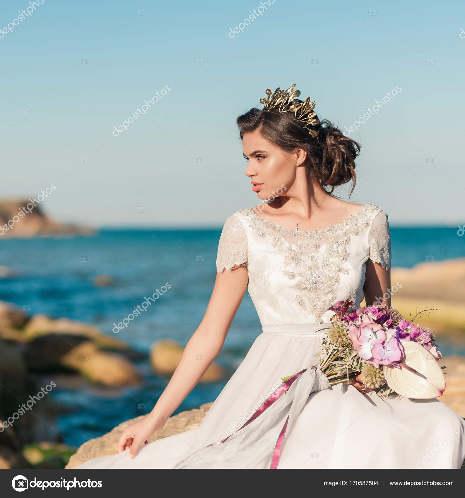 Beautiful bride outdoors. Wedding hairstyle and make up outdoors ...