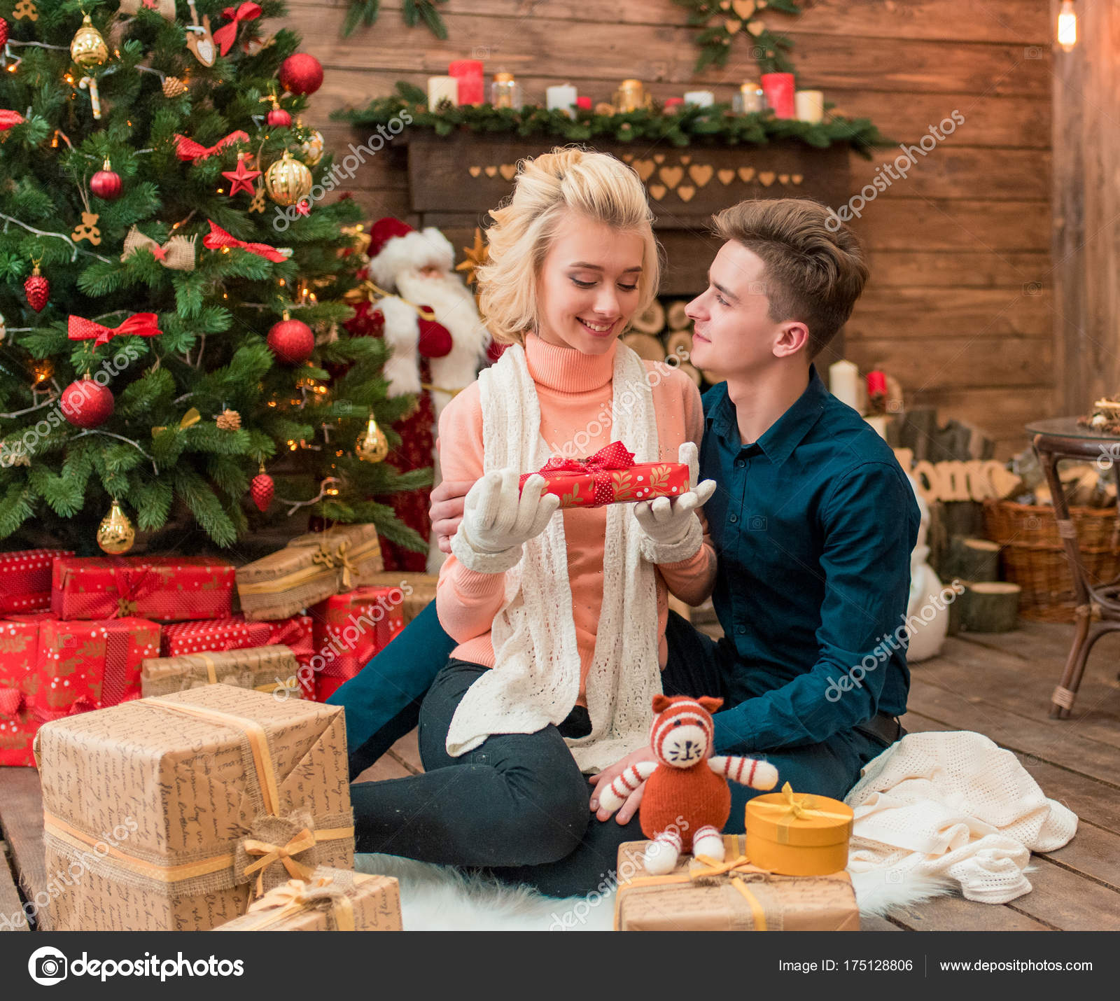 Beautiful Christmas Gifts For Married Couples Young Part - 8: Happiness Young Adult Couple With Gift Boxes In A Warm Home Atmosphere  Celebrating Christmas. Young Just Married Couple In Love.