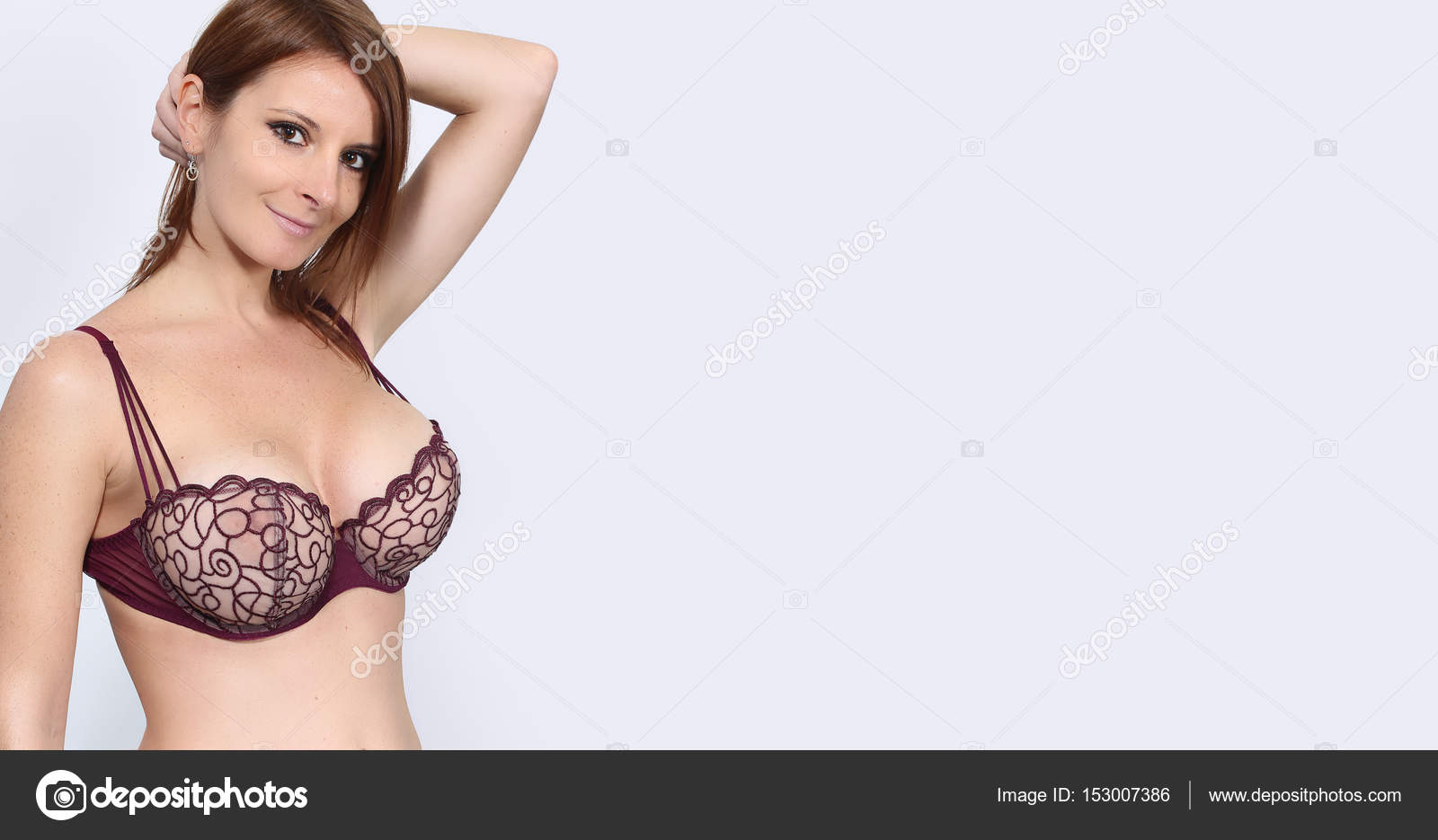 606e8a5d2 Banner of a beautiful woman posing with a bra - breast implant concept–  stock image