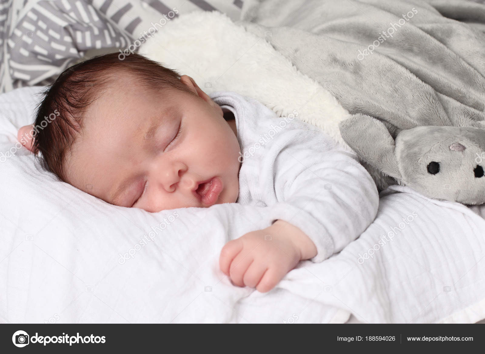beautiful baby girl sleeping her stomach — stock photo © rdrgraphe