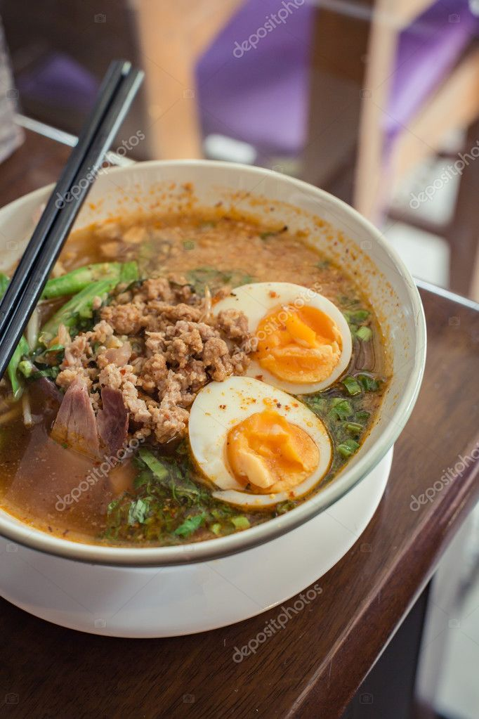 Noodle Tom Yam, hot spicy soup served with boiled egg