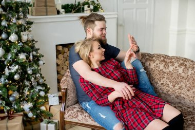 Happy couple of lovers sitting on the sofa