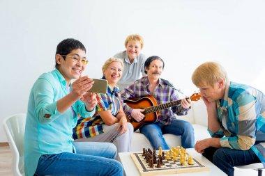 Senior people playing board games