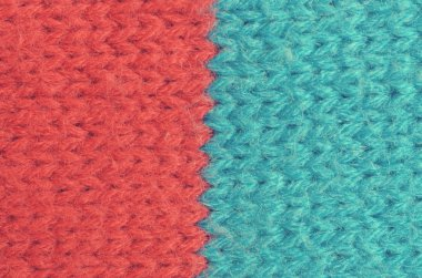 Textile texture of wool of red and blue colors.