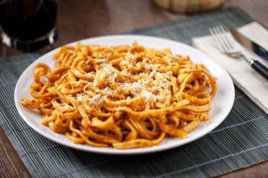 Tagliatelle with tomato sauce and pesto