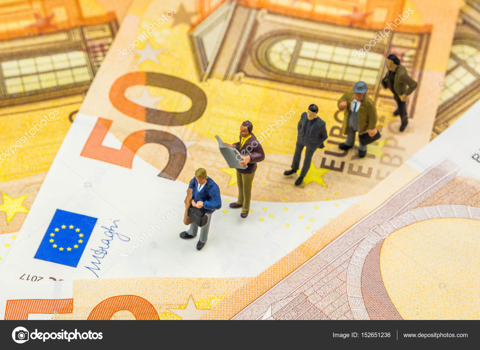 Little Figurines Standing In Line On New 50 Euro Banknotes Stock