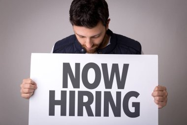 paper with sign Now Hiring