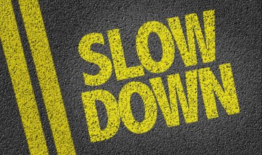 yellow sign slow down