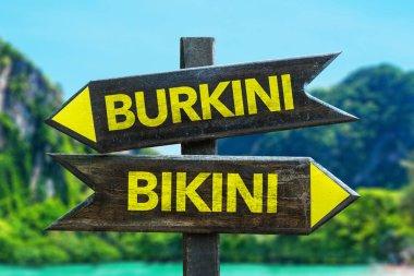 Burkini vs Bikini wooden roadsign