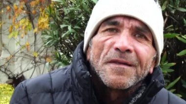 Closeup portrait of a Chilean senior man outdoors