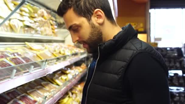 Young Man Shopping at Supermarket