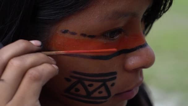 Native Brazilian Woman (India) Painting on her Face in a Indigenous Tribe