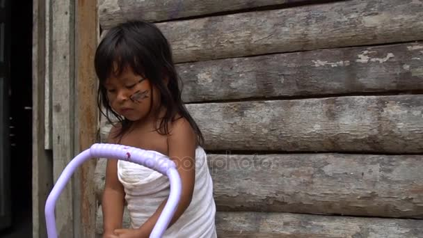 Brazilian Native Indian Child having fun with a Doll