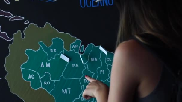 Traveler Woman Putting Pin Location of Travelled Countries the Map