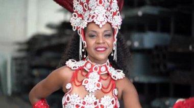 Brazilian Woman Sending a Air Kiss with Carnaval costume