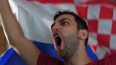 Croatian fan celebrating with flag