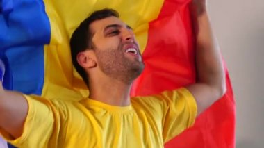Romania fan celebrating with flag