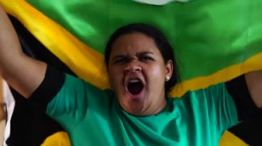 Jamaican Woman Celebrating with National Flag