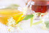 Tea with flowers of a linden and white honey