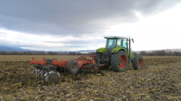 tractor cultivating ground of agro field