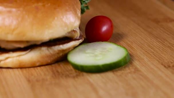 Fresh appetizing hamburger rotating background.