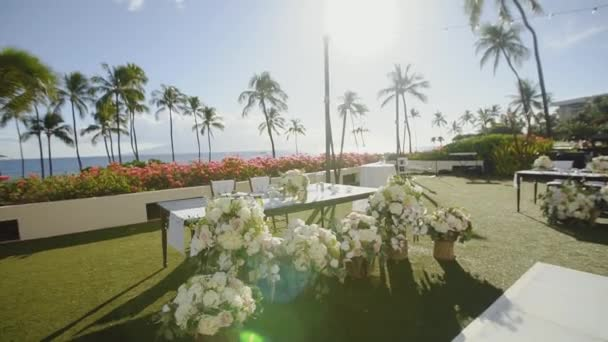 white flowers near the table of the newlyweds at the wedding banquet on the background of tropical nature of resort hyatt,maui,hawaii
