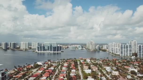 beautiful aerial picture of charming houses and cityscape with business buildings on the sunny isles beach,miami