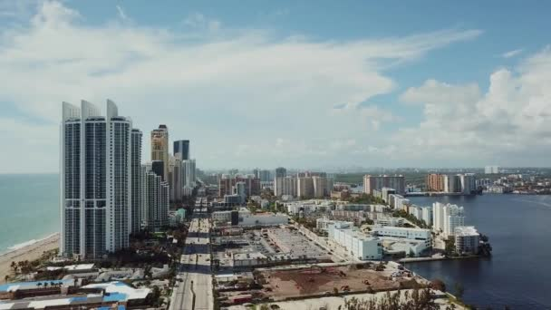aerial footage of miami with skyscrapers and business centres on sunny isles beach under cloudy sky