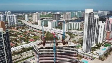 Aerial picture of highrise buildings ,financial corporations ,residental houses on the ocean shore sunny isles beach,miami