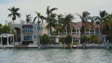 Exclusive mansions of celebrities with tropical trees on the shore of star island,sunny isles beach,miami
