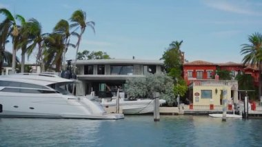 Luxurious private boat near fascinating house of wealthy people on star island,sunny isles beach,miami