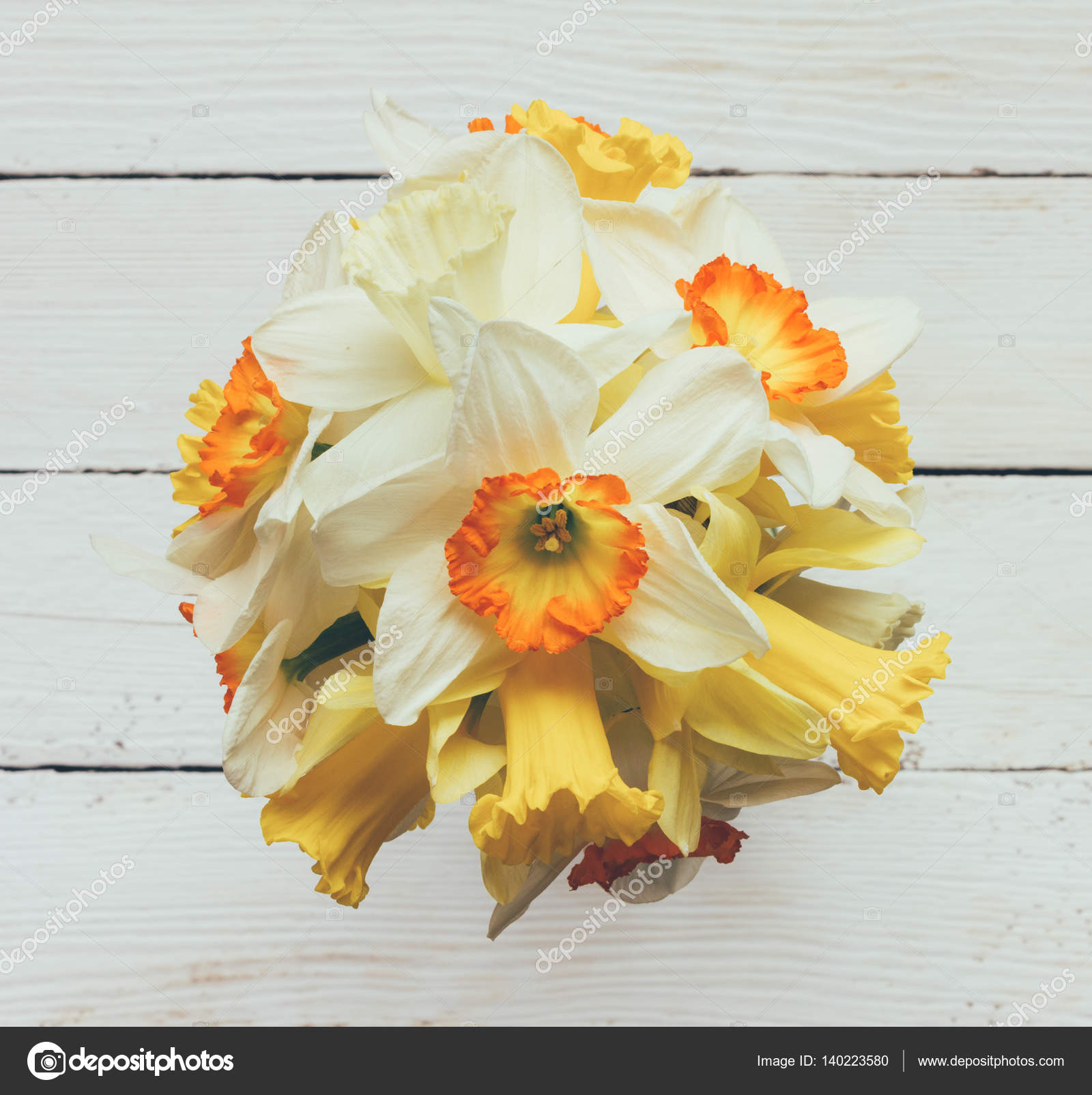 A Bouquet Of Fresh Flowers Narcissus On White Wooden Background Top