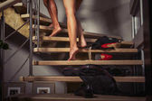Photo Couple going upstairs to the bedroom