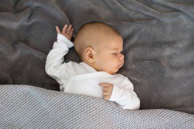 Baby sleeping on his back