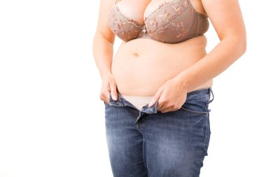 Overweight woman can't close her jeans