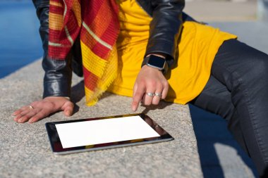 Person using blank screen tablet