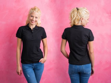 Woman in black polo T-shirt on pink background