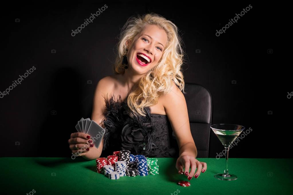 Excited and happy woman playing cards