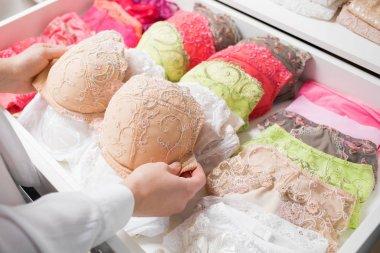 Woman organizing underwear in drawer