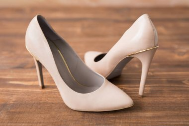 Nude high heels on wooden background