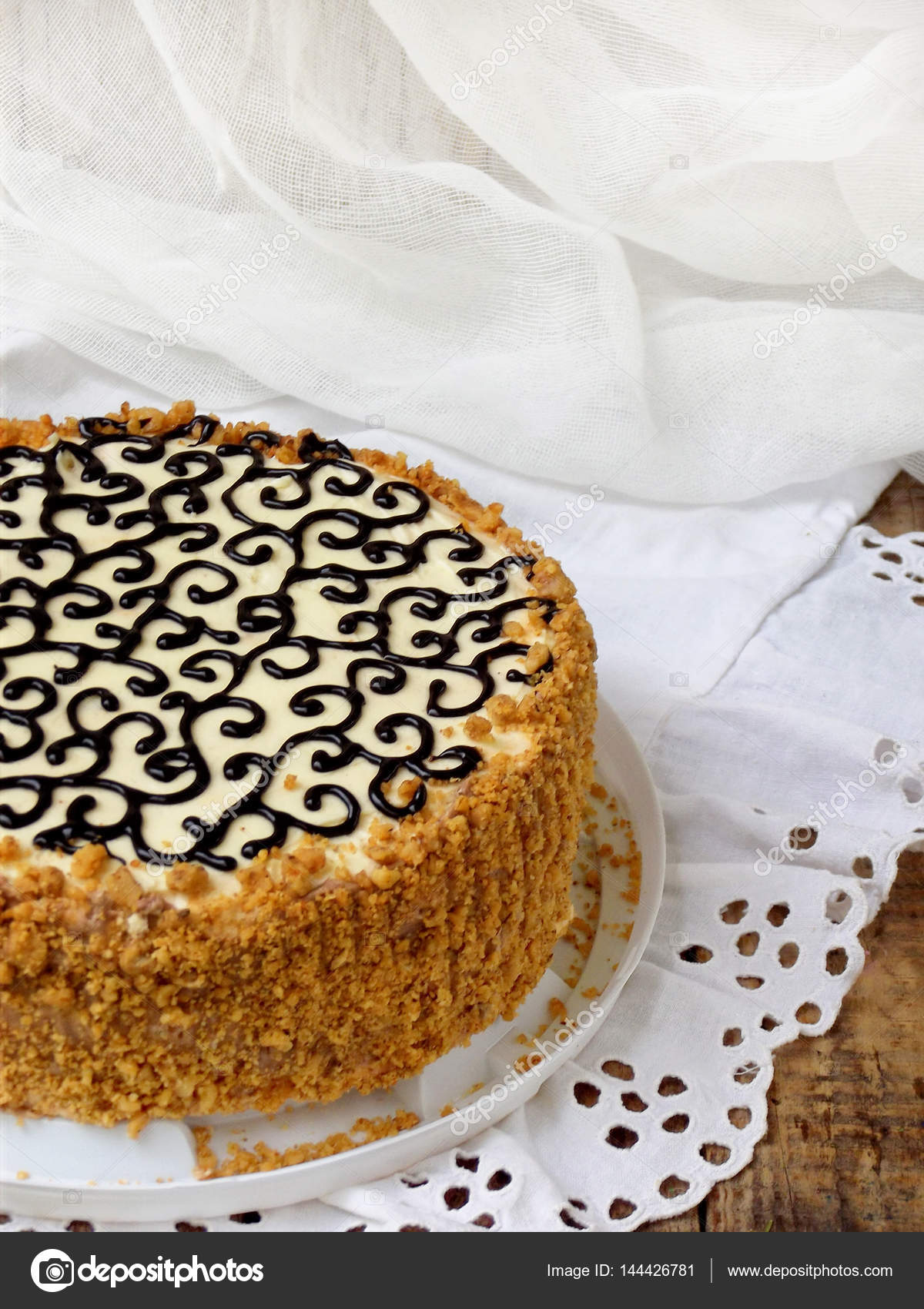 Homemade Cake With Nut Meringue Butter Cream And Decorated With