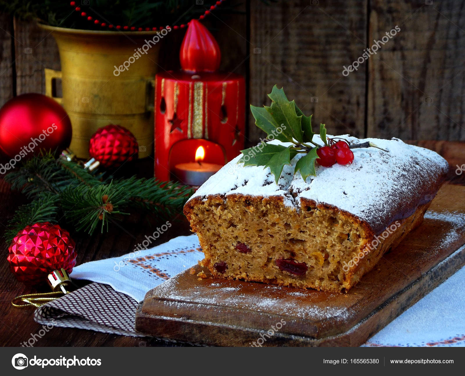 traditional christmas fruit cake decorated with powdered sugar and mas decorations candle copy space - Christmas Fruit Cake Decoration