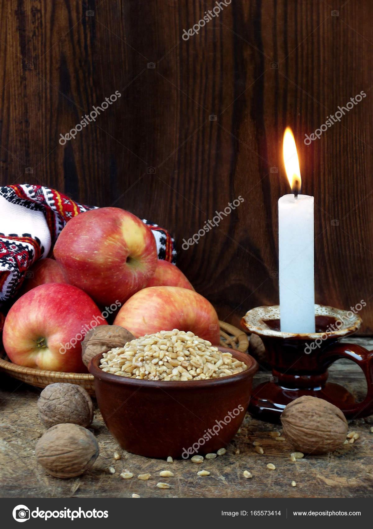 Ukrainian christmas concept for greeting card composition of ukrainian christmas concept for greeting card composition of burning candle apples walnuts m4hsunfo