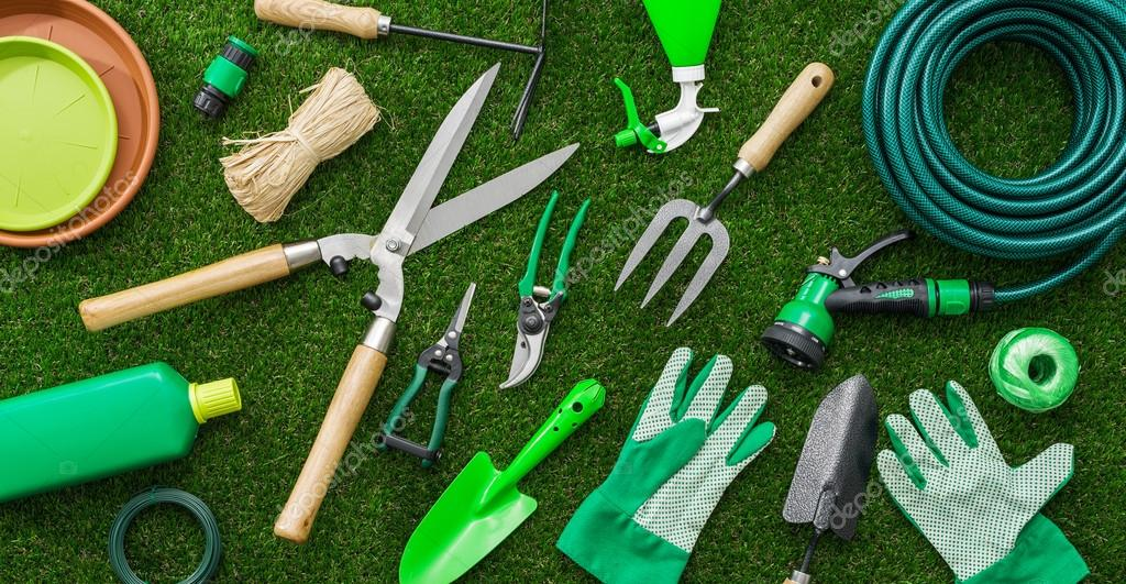 Gardening tools and utensils on a lush green meadow