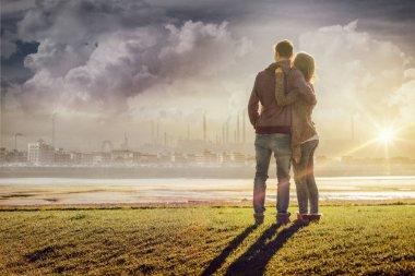 Happy romantic loving couple at the lake