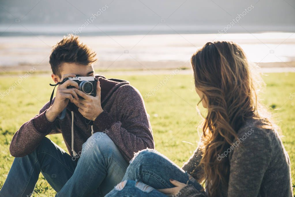 Friends taking pictures outdoors