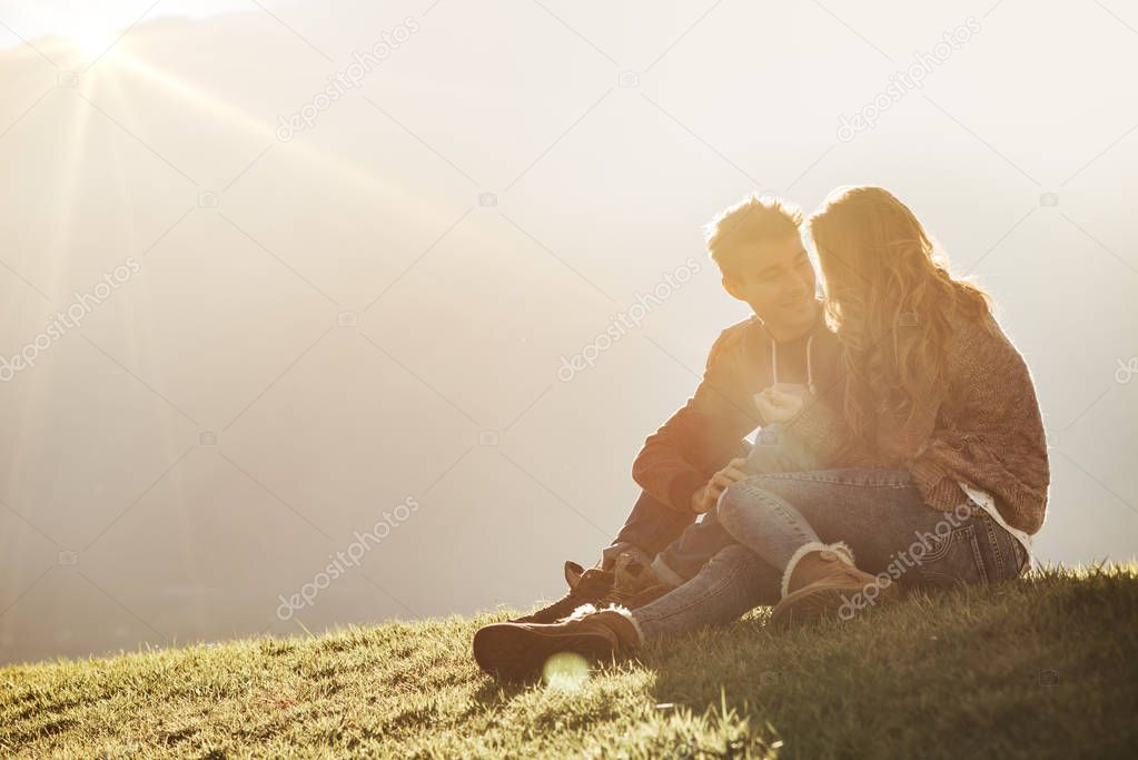 Young couple sitting on the grass